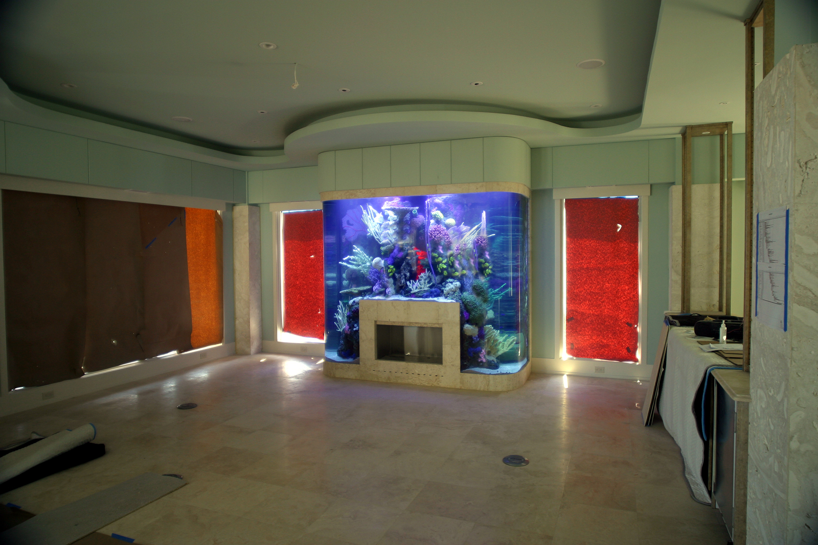 22 fireplaces that will make you insanely jealous for Fish tank fireplace